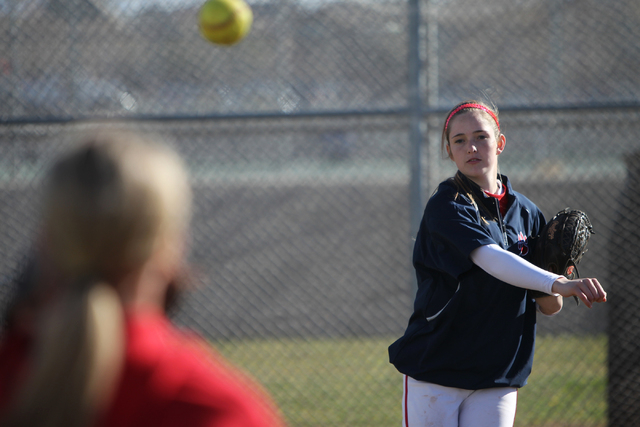 Sarah Pinkston, 16, pitcher for Coronado's varsity softball team, throws the ball during a team practice at the Coronado High School softball field in Henderson, Nev., Monday, March 2, 2105. Pinks ...