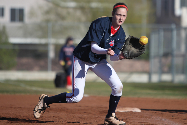 Sarah Pinkston, 16, pitcher for Coronado's varsity softball team, makes a catch during a team practice at the Coronado High School softball field in Henderson, Nev., Monday, March 2, 2105. Pinksto ...