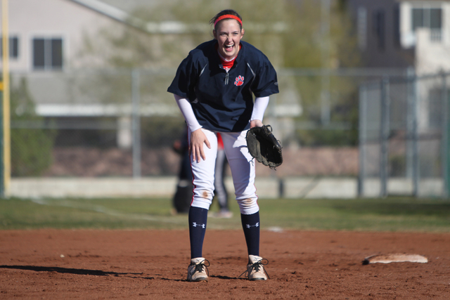 Sarah Pinkston, 16, pitcher for Coronado's varsity softball team, shares a laugh with teammates during a practice at the Coronado High School softball field in Henderson, Nev., Monday, March 2, 21 ...
