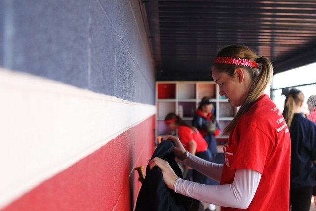 Sarah Pinkston, 16, pitcher for Coronado's varsity softball team, gets ready for a team practice at the Coronado High School softball field in Henderson, Nev., Monday, March 2, 2105. Pinkston, who ...