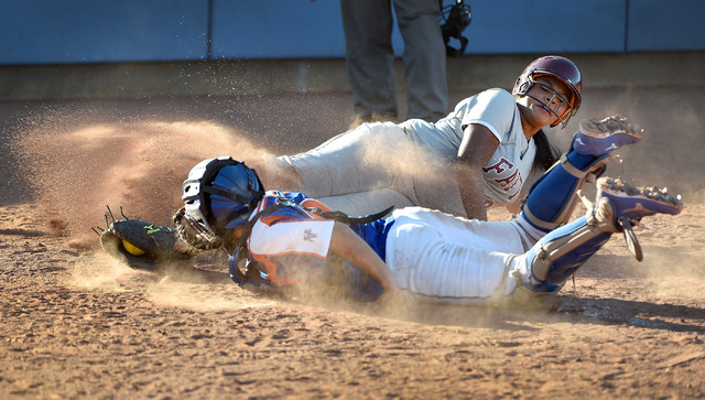 Faith Lutheran's Cheyenne Kidd slides safely into home plate against Bishop Gorman catcher Megan Coyle during a high school softball game at Bishop Gorman High School on Monday, March 9, 2015, in  ...