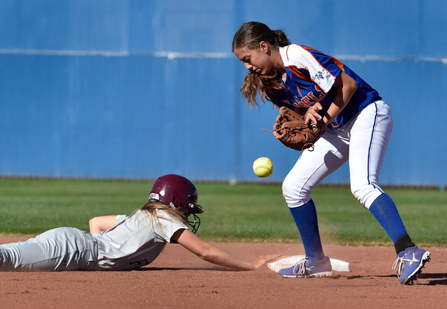 Faith Lutheran's Makena Martin, left, beats the tag at second base against Bishop Gorman's Reyna Martin during a high school softball game at Bishop Gorman High School on Monday, March 9, 2015, in ...