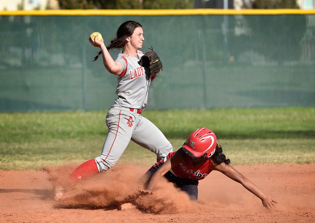 Arbor View second baseman Kellie Anderson, left, forces out Liberty's Kelsey Camat-Toki (cq) during a high school softball game at Liberty High School on Tuesday, March 24, 2015, in Henderson. Arb ...