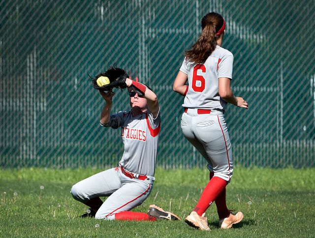 Arbor View center fielder Brittany Henricksen grabs a fly ball as Sarah Bradford looks on during a high school softball game against Liberty at Liberty High School on Tuesday, March 24, 2015, in H ...