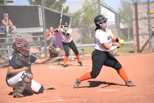 Chaparrel's Ellie Horton (10) swings at a pitch against Cheyenne during their softball game played at Cheyenne's softball field in Las Vegas on Saturday, Mar. 21, 2015. (Martin S. Fuentes/Las Vega ...