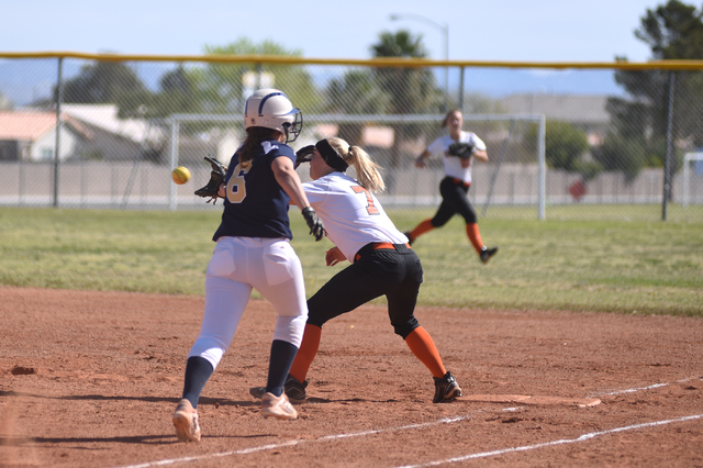 Chaparrel's Diana Jennings (7) catches the ball for an out before Cheyenne's Taylor Cole (6) reaches base during their softball game played at Cheyenne's softball field in Las Vegas on Saturday, M ...