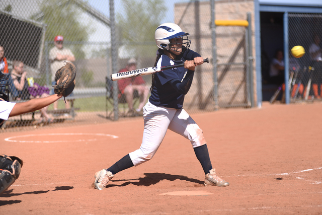 Cheyenne's Arleth Estrada (10) swings at a pitch against Chaparrel during their softball game played at Cheyenne's softball field in Las Vegas on Saturday, Mar. 21, 2015. (Martin S. Fuentes/Las Ve ...