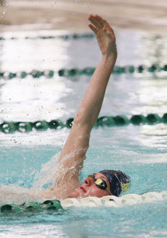 Palo Verde senior Bowen Becker, 17, swims the backstroke during a warm-up at practice at Pavilion Center Pool Wednesday, March 11, 2015, in Las Vegas. The freestyle sprinter is committed to the Un ...
