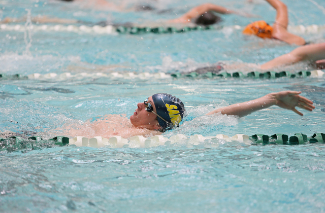 Palo Verde senior Bowen Becker, 17, front, swims the backstroke during a warm-up at practice at Pavilion Center Pool Wednesday, March 11, 2015, in Las Vegas. The freestyle sprinter is committed to ...
