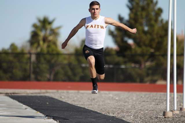 Faith Lutheran runner Mark Rubalcaba, 18, works on his long jumps during a track practice at Faith Lutheran High School in Las Vegas Monday, March 9, 2015. Rubalcaba, the defending state men's 200 ...