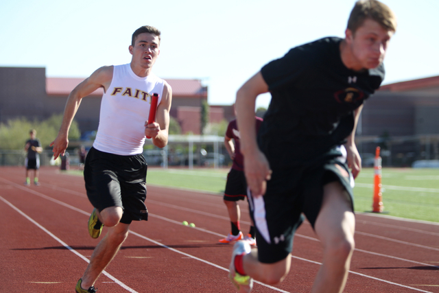 Faith Lutheran runner Mark Rubalcaba, 18, left, works on the baton pass with a teammate during a track practice at Faith Lutheran High School in Las Vegas Monday, March 9, 2015. Rubalcaba, the def ...