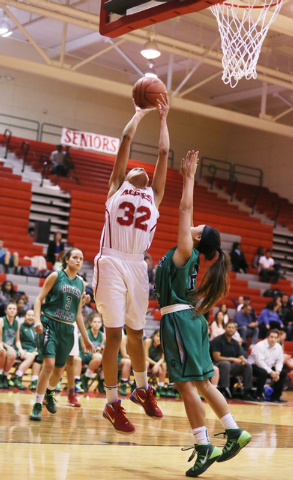 Arbor View junior Janae Strode (32) goes up for a shot as Green Valley sophomore Gwen Garcia attempts a block during a high school basketball game at Arbor View High School Monday, Dec. 9, 2013, i ...