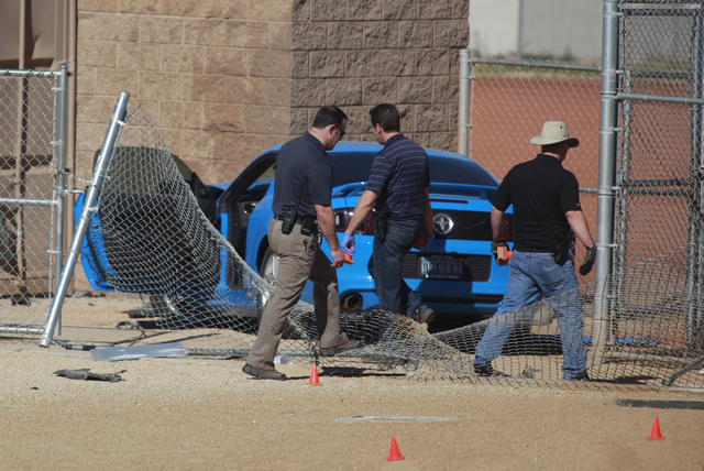 Las Vegas police investigate a suspected street-racing crash Feb. 9 involving two vehicles, one of which rolled over on a baseball field outside of Sunrise Mountain High School, 2575 Los Feliz St. ...