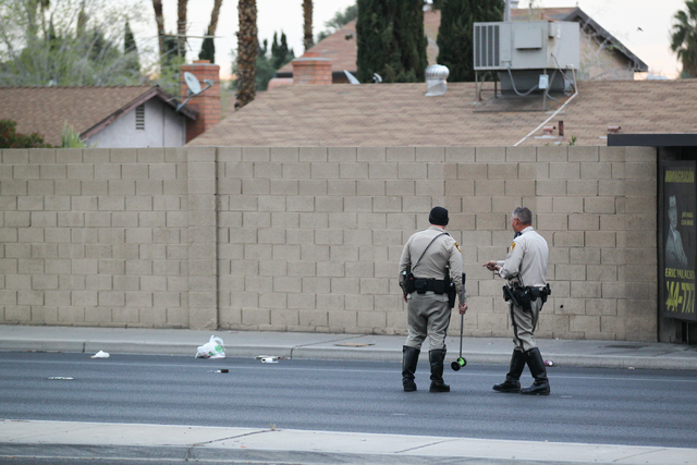 Las Vegas police investigate the scene where a woman was struck by a car on Rainbow Boulevard near Twain Avenue on Wednesday, March 11, 2015. The woman, believed to be in her 70s or 80s, was taken ...
