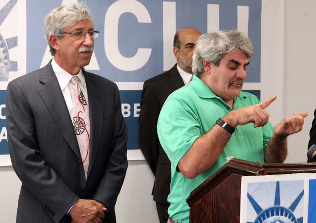 Discharged psychiatric patient James Brown, right, talks during a news conference at the America Civil Liberties Union (ACLU) of Nevada in Las Vegas, Wednesday, June 12, 2013, where he recounted b ...