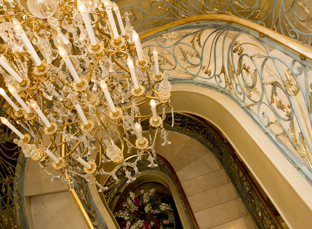 Tonya Harvey/Real Estate Millions  Continuing up to the third floor, the 18-carat gold-detailed patina and marble staircase surrounds a huge crystal chandelier that the Shulmans discovered on one  ...