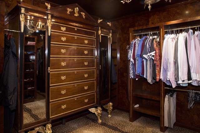 Tonya Harvey/Real Estate Millions  The walls of Barry's closet are paneled with burl birch wood, and hold a large armoire with gilded Egyptian feet and other details, imported from Europe.