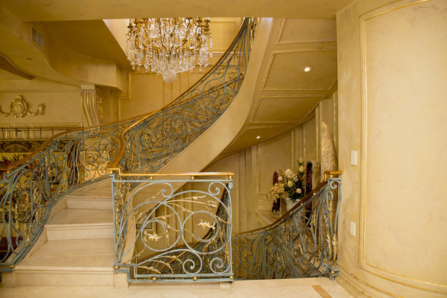 Tonya Harvey/Real Estate Millions  The penthouse's three floors are connected via an ornate, winding iron staircase, which, features 18-carat gold-detailed patina.