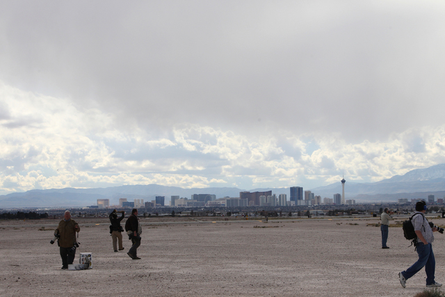Photographers wait for planes to take the air during the Red Flag exercises at Nellis Air Force Base in Las Vegas, Tuesday, March 3, 2015. The event was the second Red Flag at Nellis Air Force Bas ...