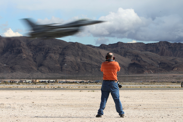 Photographer Issac Lebowitz  takes photos of an aircraft as it takes flight during the Red Flag exercises at Nellis Air Force Base in Las Vegas, Tuesday, March 3, 2015. The event was the second Re ...