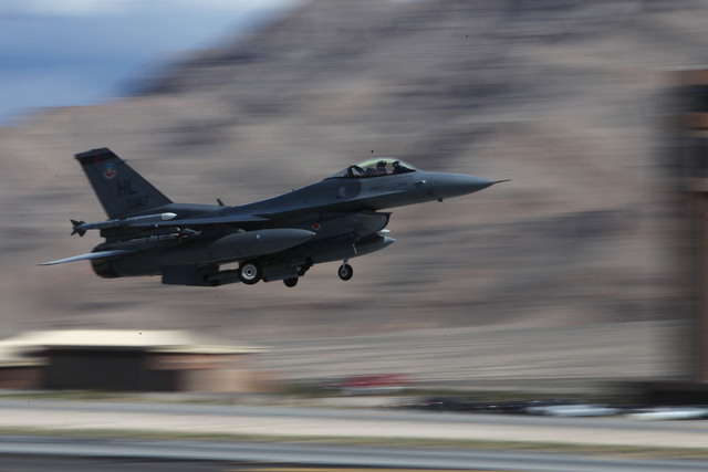 A Hill Air Force Base F-16CM aircraft with the 421st Fighter Squadron takes flight during the Red Flag exercises at Nellis Air Force Base in Las Vegas, Tuesday, March 3, 2015. The event was the se ...