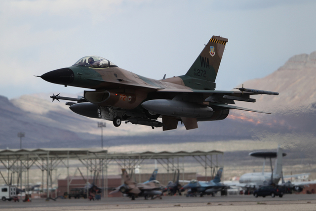 A Nellis Air Force Base F-16C with the 64th Aggressors takes flight during the Red Flag exercises at Nellis Air Force Base in Las Vegas, Tuesday, March 3, 2015. The event was the second Red Flag a ...