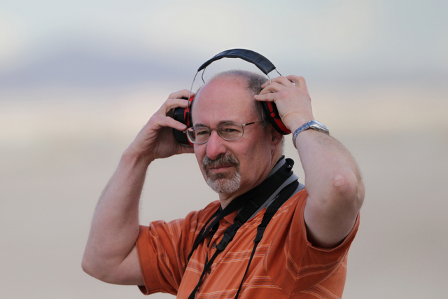 Photographer Issac Lebowitz adjusts his ear protection during the Red Flag exercises at Nellis Air Force Base in Las Vegas Tuesday, March 1, 2015. The event was the second Reg Flag at Nellis Air F ...