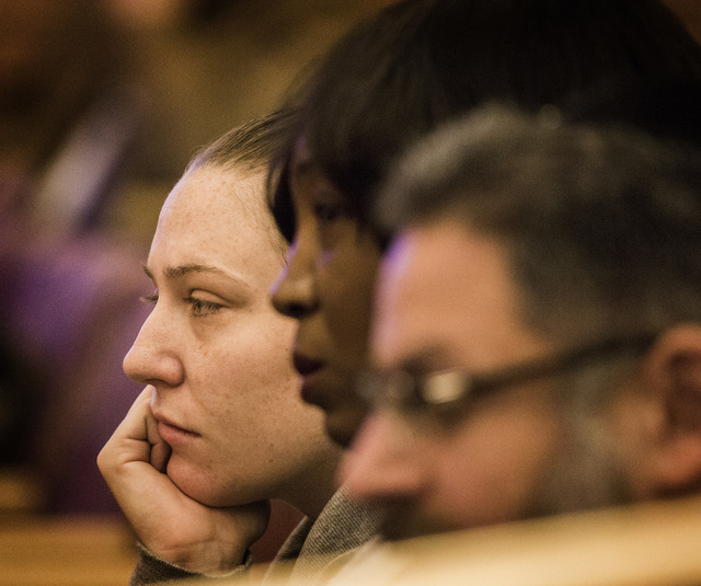 Lauren Drummond, left, sister-in-law to DՁndre Berghardt Jr and Tracy Meadows, mother of  Berghardt, sit with their attorney Jacob Hafter  during the Police Fatality Public Fact-finding Revi ...