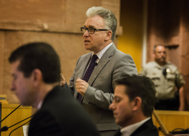 Ombudsman Mark Bailus  asks a question to Las Vegas Police Detective Matthew Gillis  during the Police Fatality Public Fact-finding Review on  DՁndre Berghardt Jr.  at  the Clark County Gove ...