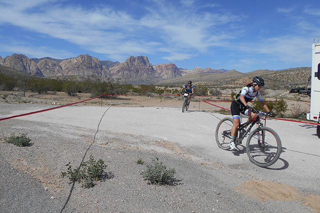 Mountain bikers finish another lap as they come into the staging area in Blue Diamond. (Alan Snel/Las Vegas Review-Journal)