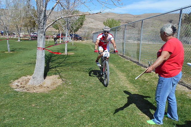 A mountain bicyclist checks in with a race volunteer. (Alan Snel/Las Vegas Review-Journal)
