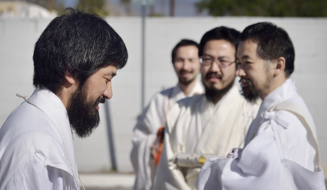 Rev. Douglas Shoda Kanai, left, is seen with some of his fellow priests before the start of a peace march at the Nichiren Buddhist Kannon Temple of Nevada at 1600 E. Sahara Ave. in Las Vegas on Su ...