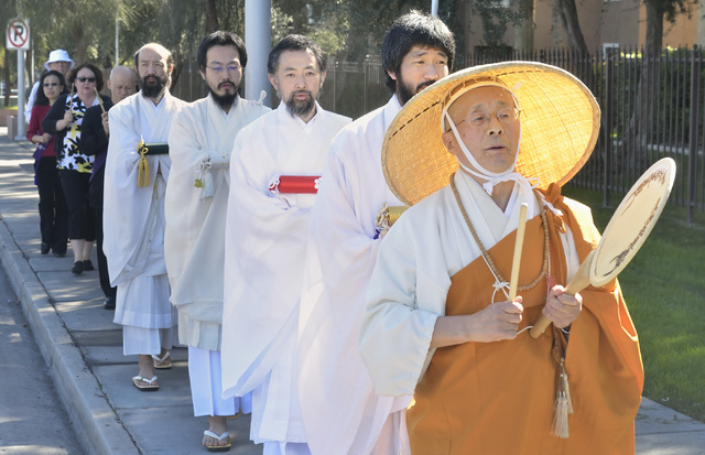 Rev. Shokai Kanai leads a peace march east on Sahara Avenue as part of a service at the Nichiren Buddhist Kannon Temple of Nevada at 1600 E. Sahara Ave. in Las Vegas on Sunday, March 8, 2015. (Bil ...