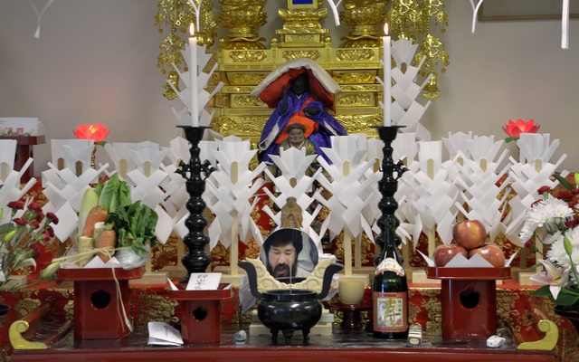 Rev. Douglas Shoda Kanai is seen reflected in a mirror on the altar at the Nichiren Buddhist Kannon Temple of Nevada at 1600 E. Sahara Ave. in Las Vegas on Sunday, March 8, 2015. Rev. Kanai was pa ...
