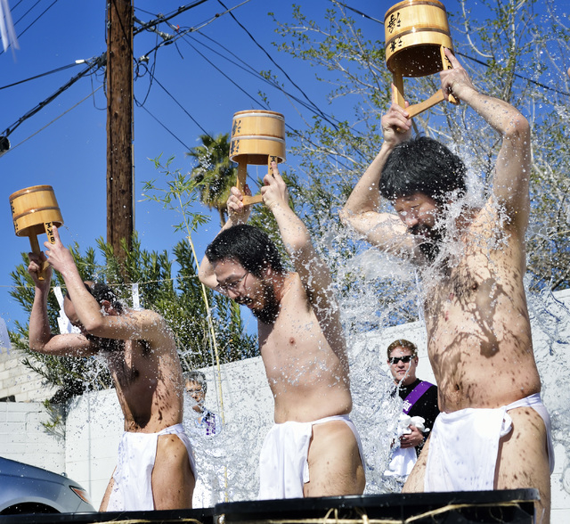 Rev. Douglas Shoda Kanai, right, takes part in a water purification ritual with Rev. Shinko Kuwaki, left, and Rev. Kanryu Ueda at the Nichiren Buddhist Kannon Temple of Nevada at 1600 E. Sahara Av ...