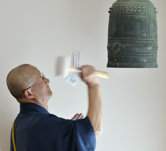 Rev. Shokai Kanai rings a bell to begin a service at the Nichiren Buddhist Kannon Temple of Nevada at 1600 E. Sahara Ave. in Las Vegas on Sunday, March 8, 2015. He was participating in a ceremony  ...