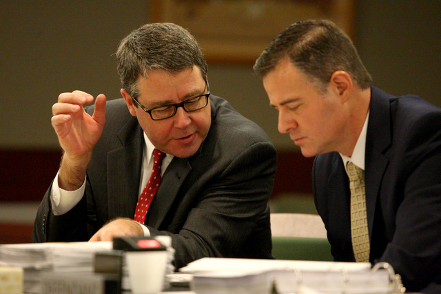 Attorneys Thomas Carroll, left, and Matthew Christian, representing the District Attorney's office, confer over points made by Review-Journal attorney, Maggie McLetchie, over access to public reco ...