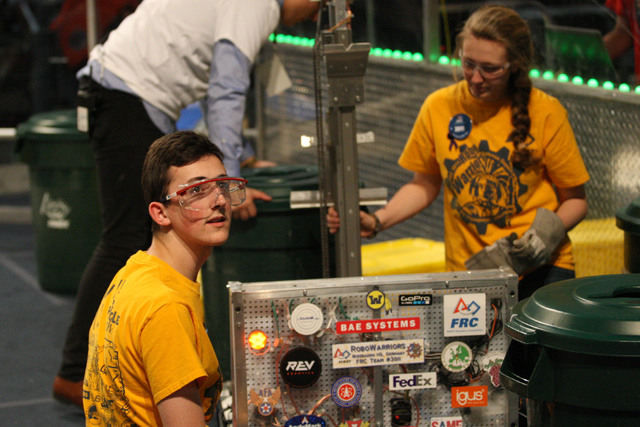 Matthew Machacek and Emily Hollingsworth, members of the team from Wiesbaden, Germany,  check their robot prior to the next round at the FIRST Robotics Competition at Cashman Center in Las Vegas o ...