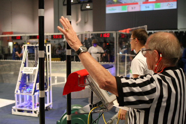 First Robotics Competition official Paul MacDowell signals the teams during the Recycle Rush challenge at the FIRST Robotics Competition at Cashman Center in Las Vegas on Thursday, March 26, 2015. ...