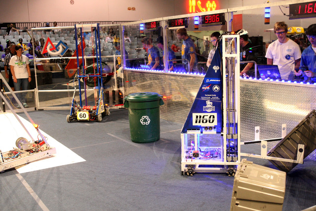 Three random teams from across the world compete against three other teams for the highest score in the Recycle Rush challenge at the FIRST Robotics Competition at Cashman Center in Las Vegas on T ...