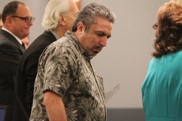 Donnie Placencia, a co-defendant in stealing over $100,000 in public funds from the Clark County School District Adult English Language Acquisition Services program, stands during his plea hearing ...