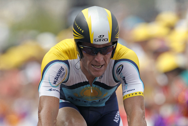 Astana rider Lance Armstrong of the U.S. reacts as he arrives at the finish line during the individual time trial in the first stage of the 96th Tour de France cycling race in Monaco, July 4, 2009 ...