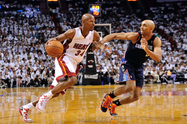 Apr 23, 2014; Miami, FL, USA; Miami Heat guard Ray Allen (34) drives to the basket as Charlotte Bobcats guard Gerald Henderson (9) defends in game two during the first round of the 2014 NBA Playof ...