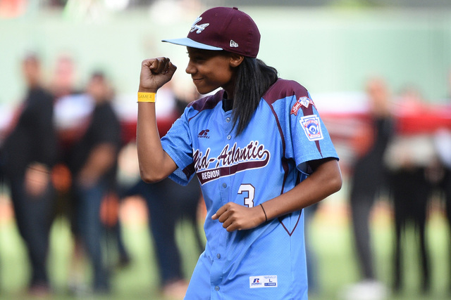 Oct 25, 2014; San Francisco, CA, USA; Little League player Mo'ne Davis reacts after throwing out the ceremonial first pitch before game four of the 2014 World Series between the San Francisco Gian ...