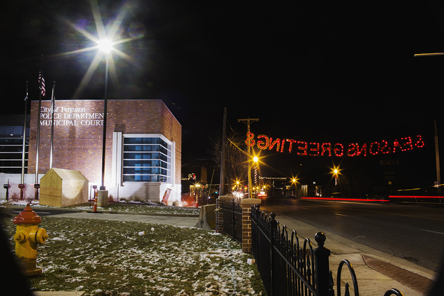 A holiday sign hangs in front of the Ferguson Police Department on a Thanksgiving evening that has thus far been devoid of protests in Ferguson, Missouri November 27, 2014. The Ferguson mayor says ...