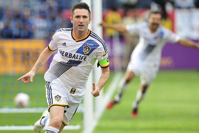 Los Angeles Galaxy forward Robbie Keane (7) celebrates after scoring a goal against the New England Revolution in the overtime during the 2014 MLS Cup final at Stubhub Center, Dec 7, 2014. (Gary A ...