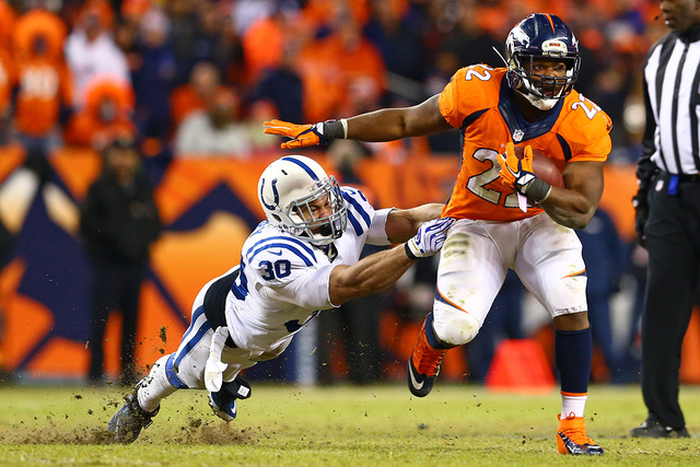 Jan 11, 2015; Denver, CO, USA; Indianapolis Colts safety LaRon Landry (30) dives to tackle Denver Broncos running back C.J. Anderson (22) in the second half in the 2014 AFC Divisional playoff foot ...