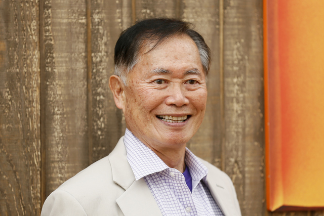 """Cast member George Takei poses at the world premiere of the animated film """"Free Birds"""" in Los Angeles, October 13, 2013. (REUTERS/Danny Moloshok)"""