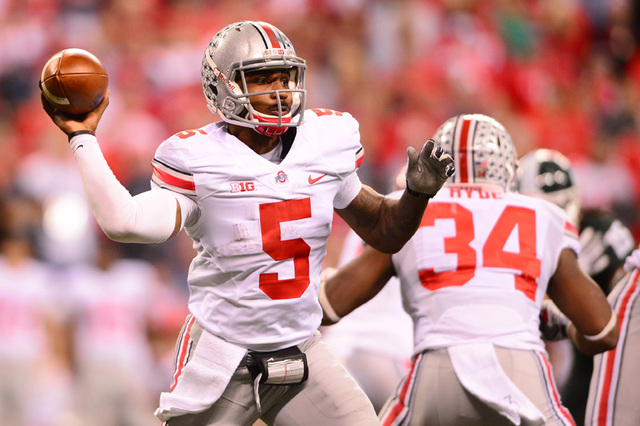Dec 7, 2013; Indianapolis, IN, USA; Ohio State Buckeyes quarterback Braxton Miller (5) throws a pass during the third quarter of the 2013 Big 10 Championship game against the Michigan State Sparta ...