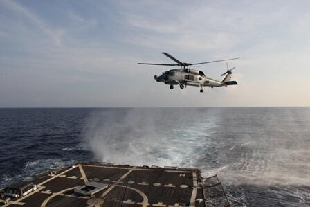 US Navy SH-60R Seahawk departs to aid in the search efforts of the missing airliner. MH370 Malaysia Airlines .